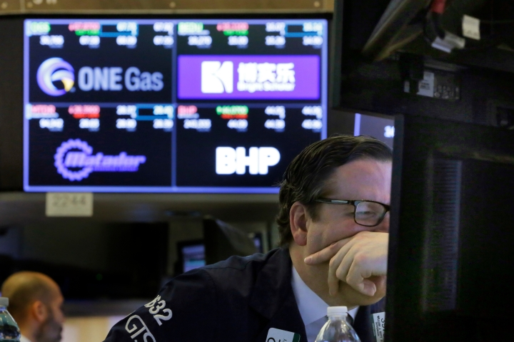 Specialist Gregg Maloney works on the floor of the New York Stock Exchange, Friday, April 6, 2018. Another increase in trade tensions has stocks reversing course and falling again Friday morning as the U.S. considers an even larger set of tariffs on imports from China. (AP Photo/Richard Drew)