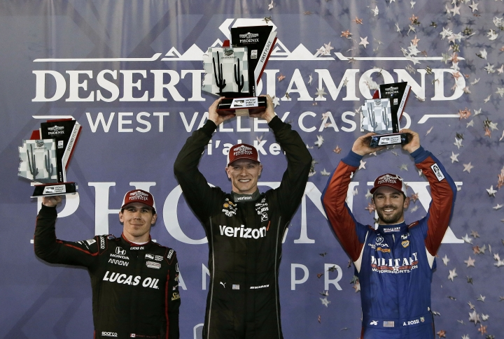 Josef Newgarden, middle, who won the race, celebrates with second-place Robert Wickens, left, and third-place Alexander Rossi after the IndyCar auto race Saturday, April 7, 2018, at Phoenix International Raceway in Avondale, Ariz. (AP Photo/Rick Scuteri)