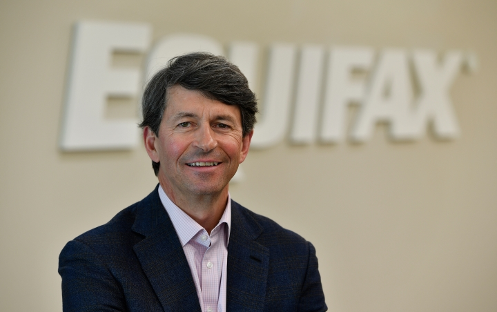 FILE- In this March 28, 2018, file photo Equifax CEO Mark Begor poses for a photo in Atlanta. Equifax announced last month that Begor, a long-time financial industry executive, would be taking over as permanent CEO of the company. (AP Photo/Mike Stewart, File)