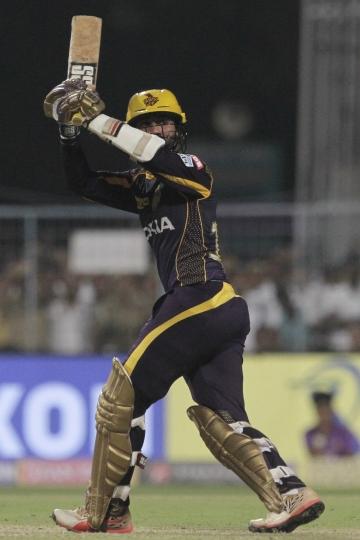 Kolkata Knight Riders' Dinesh Karthik hits a ball during VIVO IPL cricket T20 match against Royal Challengers Bangalore in Kolkata, India, Sunday, April 8, 2018. (AP Photo/Bikas Das)