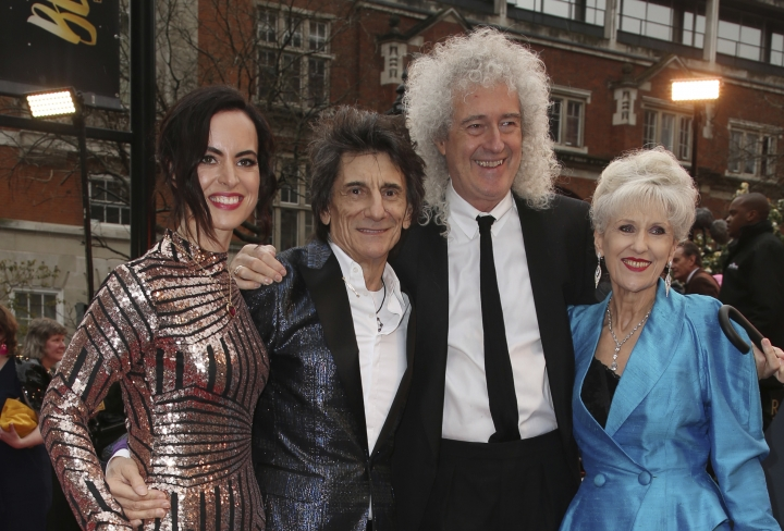 Sally Wood, from left, musicians Ronnie Wood, Brian May and actress Anita Dobson pose for photographers upon arrival at the Olivier Awards in London, Sunday, April 8, 2018. (Photo by Joel C Ryan/Invision/AP)