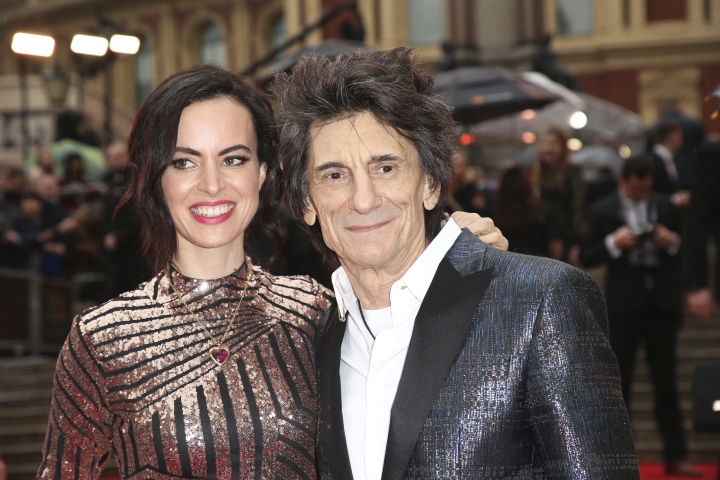 Musician Ronnie Wood, right, and Sally Wood pose for photographers upon arrival at the Olivier Awards in London, Sunday, April 8, 2018. (Photo by Joel C Ryan/Invision/AP)