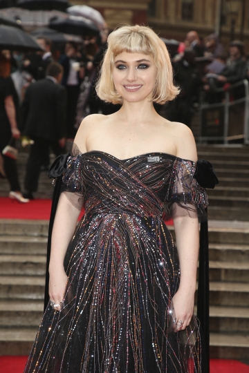 Actress Imogen Poots poses for photographers upon arrival at the Olivier Awards in London, Sunday, April 8, 2018. (Photo by Joel C Ryan/Invision/AP)