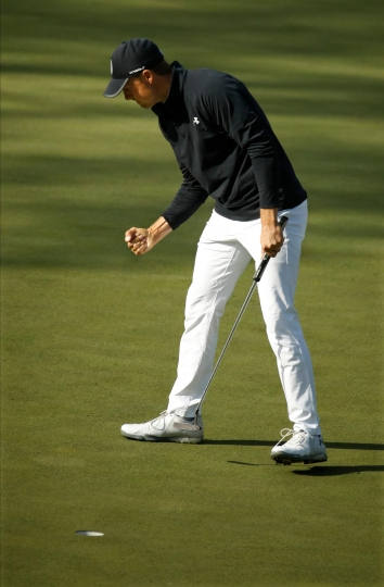 Jordan Spieth reacts to his birdie on the 15th hole during the fourth round at the Masters golf tournament Sunday, April 8, 2018, in Augusta, Ga. (AP Photo/Charlie Riedel)