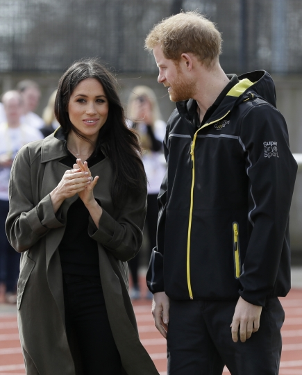 Britain's Prince Harry and his fiancee Meghan Markle attend the UK team trials for the Invictus Games Sydney 2018 at the University of Bath in Bath, England, Friday, April 6, 2018. The Invictus Games is the only international sport event for wounded, injured and sick (WIS) servicemen and women, both serving and veteran. The Invictus Games Sydney 2018 will take place from 20-27th October and will see over 500 competitors from 18 nations compete in 11 adaptive sports. (AP Photo/Kirsty Wigglesworth, pool)