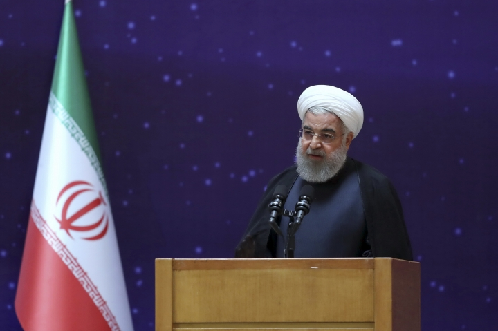 """In this photo released by an official website of the office of the Iranian Presidency, President Hassan Rouhani speaks in a ceremony to mark """"National Nuclear Day,"""" dedicated to the country's achievements in nuclear technology, in Tehran, Iran, Monday, April 9, 2018. Rouhani said Monday that despite many attempts, the U.S. has """"failed to destroy"""" the landmark 2015 deal between Iran and world powers. (Iranian Presidency Office via AP)"""