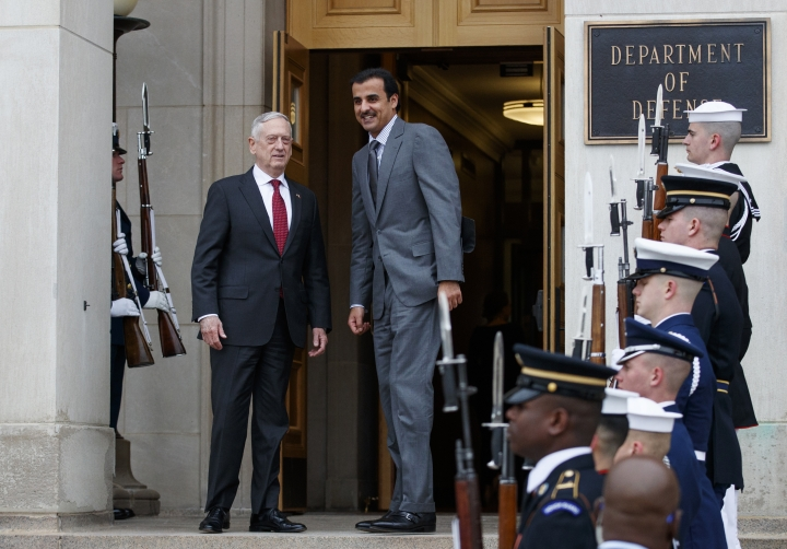 Defense Secretary Jim Mattis, left, stands with Emir of Qatar Sheikh Tamim bin Hamad al-Thani during an Honor Cordon at the Pentagon, Monday, April 9, 2018. (AP Photo/Carolyn Kaster)