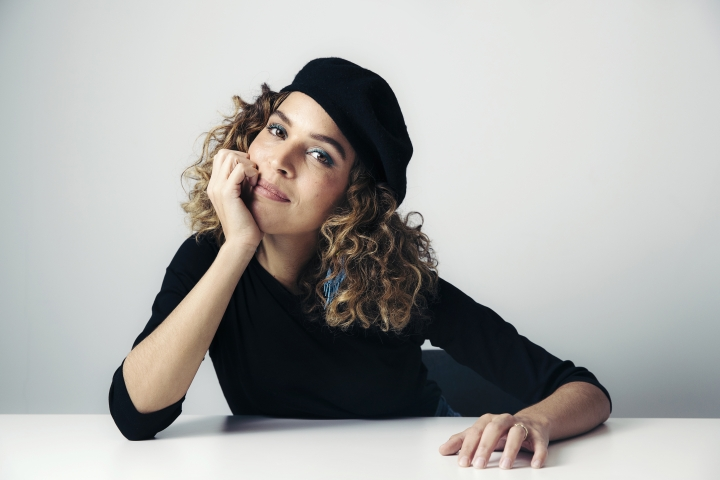 """This March 20, 2018 photo shows poet and activist Cleo Wade posing for a portrait in New York to promote her book, """"Heart Talk."""" (Photo by Victoria Will/Invision/AP)"""