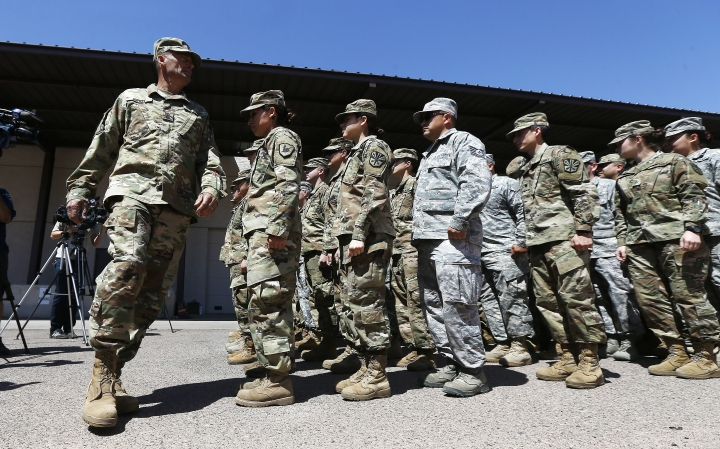 Arizona National Guard soldiers line up as they get ready for a visit from Arizona Gov. Doug Ducey prior their deployment to the Mexico border at the Papago Park Military Reservation Monday, April 9, 2018, in Phoenix. (AP Photo/Ross D. Franklin)