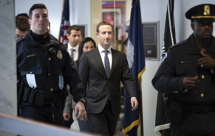 Facebook CEO Mark Zuckerberg leaves a meeting with Sen. Bill Nelson, D-Fla., the ranking member of the Senate Commerce Committee, on Capitol Hill in Washington, Monday, April 9, 2018. Zuckerberg will testify Tuesday before a joint hearing of the Commerce and Judiciary Committees about the use of Facebook data to target American voters in the 2016 election. (AP Photo/J. Scott Applewhite)