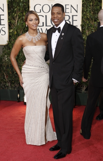 FILE - In this Jan. 11, 2009 file photo, Beyonce, left, is joined by husband Jay-Z, as she arrives at the 66th Annual Golden Globe Awards in Beverly Hills, Calif. The couple married on April 4, 2008 and have three children. (AP Photo/Matt Sayles, file)