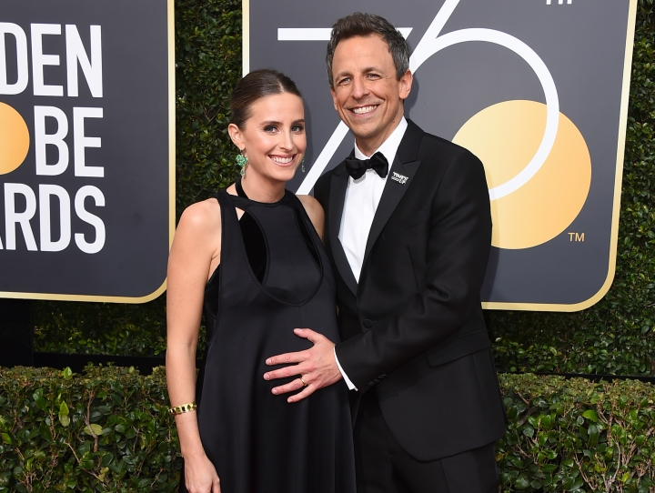 "FILE - In this Jan. 7, 2018 file photo, Alexi Ashe, left, and Seth Meyers arrive at the 75th annual Golden Globe Awards in Beverly Hills, Calif. Myers host told his audience on ""Late Night with Seth Meyers,"" Monday, April 9, 2018, that his new son was born in the lobby of their apartment building on Sunday. (Photo by Jordan Strauss/Invision/AP, File)"