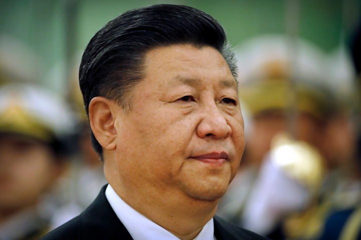 FILE - In this March 29, 2018, file photo, Chinese President Xi Jinping reviews an honor guard during a welcome ceremony at the Great Hall of the People in Beijing. Xi has promised to cut China's auto import tariffs and ease restrictions on foreign ownership in its auto industry amid an escalating tariff spat with Washington, in a speech Tuesday, April 10, 2018 at a business conference. (AP Photo/Mark Schiefelbein, File)