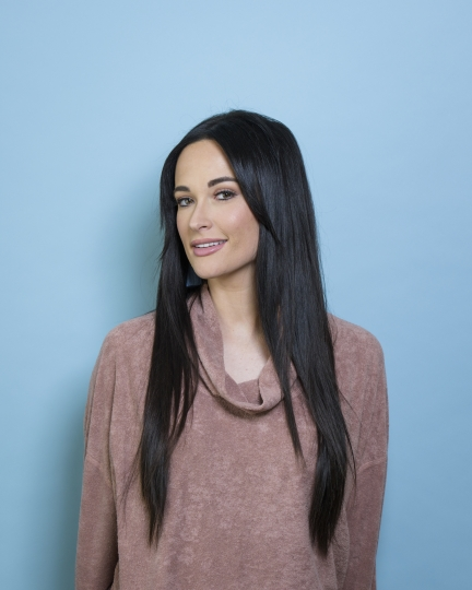 "In this March 28, 2018 photo, singer Kacey Musgraves poses for a portrait in New York to promote her third album, ""Golden Hour."" (Photo by Drew Gurian/Invision/AP)"