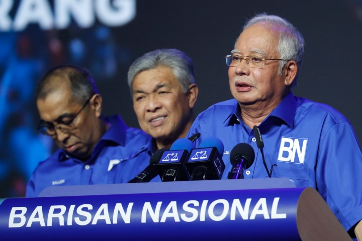"In this April 7, 2018, photo, Malaysia's Prime Minister and President of the ruling party coalition ""National Front"", Najib Razak, right, speaks to supporters during a launching event for upcoming general elections in Kuala Lumpur, Malaysia. Najib on Wednesday declared voting day on May 9, a public holiday, after a decision to hold elections on a workday triggered complaints that it would deter mainly opposition supporters. (AP Photo/Vincent Thian)"
