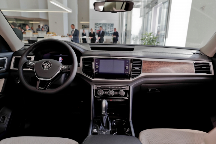 FILE- This April 11, 2017, file photo shows the interior for the 2018 Volkswagen Atlas on the showroom floor at the company's New York flagship store during a media preview for the New York International Auto Show in New York. Starting with the 2018 model year, Volkswagen offers a six-year or 72,000-mile basic warranty. This coverage effectively doubled the warranty from the prior model years and is the longest-lasting among all brands. (AP Photo/Julie Jacobson, File)