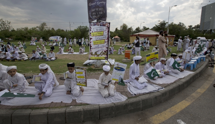 Pakistani religious students affiliated with various Islamic seminaries read Quran and pray for the victims of a deadly April 2, 2018 airstrike in the Afghan province of Kunduz, in Islamabad, Pakistan, Wednesday, April 11, 2018. An Afghan official said the airstrike was on a Taliban training camp in northern Afghanistan and killed at least 35 insurgents and wounded many more, while the Taliban said the airstrike hit a religious school during a graduation ceremony, killing dozens of civilians. (AP Photo/B.K. Bangash)