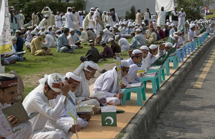 Pakistani religious students affiliated with various Islamic seminaries read Quran and pray for the victims of a deadly April 2, 2018 airstrike by Afghan forces in the Afghan province of Kunduz, in Islamabad, Pakistan, Wednesday, April 11, 2018. An Afghan official said the airstrike was on a Taliban training camp in northern Afghanistan and killed at least 35 insurgents and wounded many more, while the Taliban said the airstrike hit a religious school during a graduation ceremony, killing dozens of civilians. (AP Photo/B.K. Bangash)