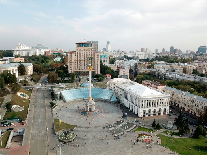 This Sept. 21, 2017 photo taken in Kiev, Ukraine, shows Maidan, the site of deadly protests in 2014 that ushered in the country's pro-European revolution. The square is now a bustling tourist hotspot and home to the towering Independence Monument. (AP Photo/Nicole Evatt)