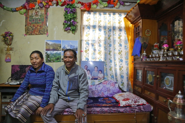 In this March 26, 2018 photo, Nepalese veteran Sherpa guide, Kami Rita, 48, poses with his wife Lhakpa Jungmu Sherpa, 45 at his rented apartment in Kathmandu, Nepal. Rita, who is one of just three people to scale Mount Everest 21 times, is about to attempt a record-breaking 22nd summit. (AP Photo/Niranjan Shrestha)