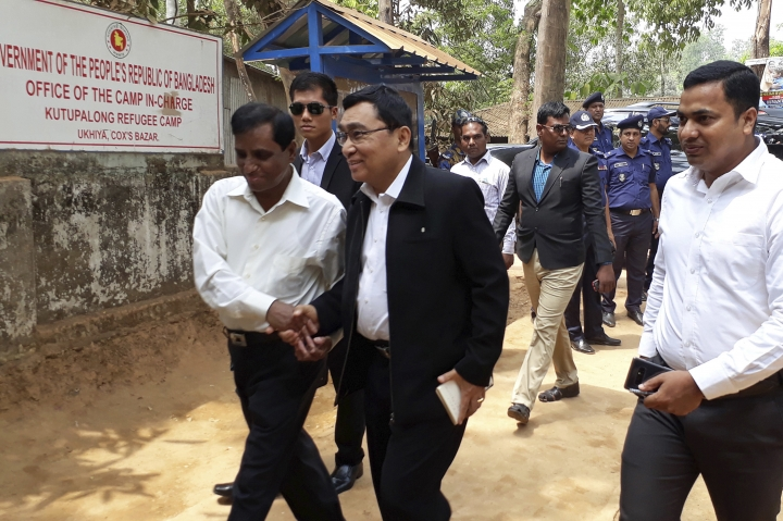 Myanmar's Social Welfare, Relief and Resettlement Minister Win Myat Aye arrives at Kutupalong refugee camp in Cox's Bazar, Bangladesh, Wednesday, April 11, 2018. About 700,000 Rohingya who face severe discrimination in Myanmar have fled to neighboring Bangladesh to escape a brutal army counterinsurgency campaign. Efforts are underway to arrange their return. (AP Photo/Suzauddin Rubel)