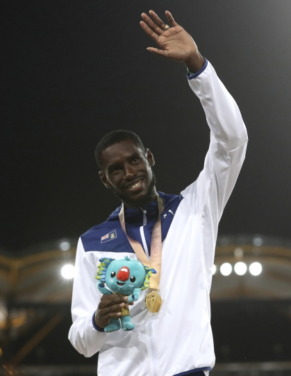 Men's 400m hurdles gold medalist Kyron McMaster of the British Virgin Islands stands podium at Carrara Stadium during the 2018 Commonwealth Games on the Gold Coast, Australia, Thursday, April 12, 2018. (AP Photo/Mark Schiefelbein)