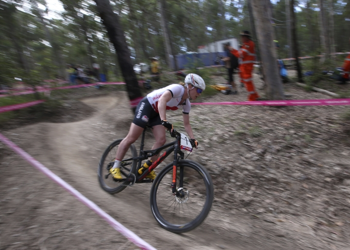 England's Annie Last rides down hill during the women's cross-country race at the Nerrang mountain bike trails during the 2018 Commonwealth Games on the Gold Coast, Australia, Thursday, April 12, 2018. (AP Photo/Rick Rycroft)