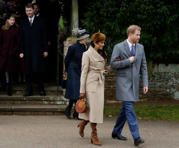 "FILE - In this Monday, Dec. 25, 2017 file photo, Britain's Prince Harry and his fiancee Meghan Markle leave the traditional Christmas Day church service, at St. Mary Magdalene Church in Sandringham, England. As Prince Harry's future bride left a church service on the grounds of Queen Elizabeth II's private country estate, designer Bojana Sentaler recognized her coat ""I was looking for the ribbed sleeves, hoping it was a Sentaler coat,'' said the designer, who met Markle when she was a mere TV star. The Meghan magic was almost instantaneous; Markle's coat sold out, as Sentaler expected, and the publicity fueled sales of other designs. (AP Photo/Alastair Grant, file)"