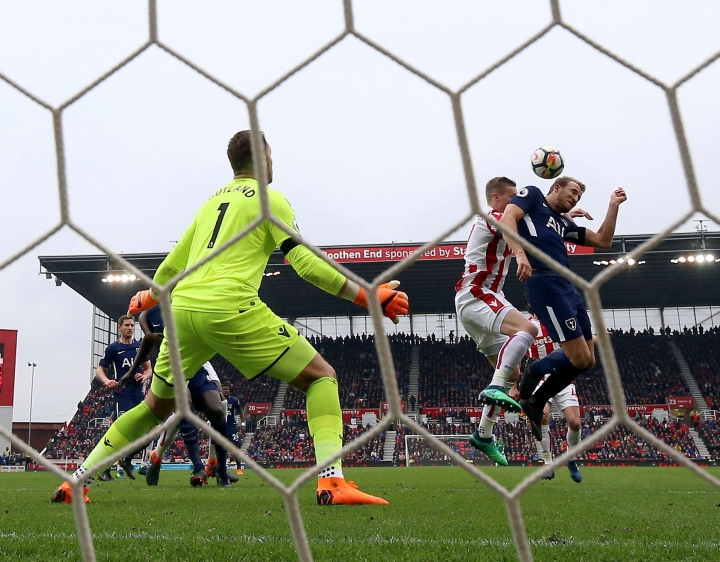 FILE - In this Saturday, April 7, 2018, file photo, Tottenham Hotspur's Harry Kane, right, attempts to get a touch on his side's second goal scored by teammate Christian Eriksen during the English Premier League soccer match against Stoke City in, England. Kane appealed to the FA that he had the final touch on the ball before it went in. On Wednesday, April 12, the league agreed and awarded the goal to Kane. (Nigel French/PA via AP, File)
