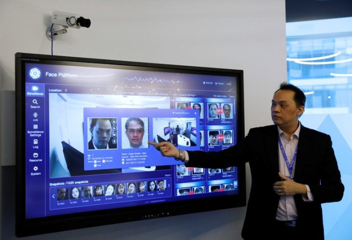 A Yitu employee showcases the company's face recognition technology in its office in Singapore April 10, 2018. Picture taken April 10, 2018. REUTERS/Edgar Su