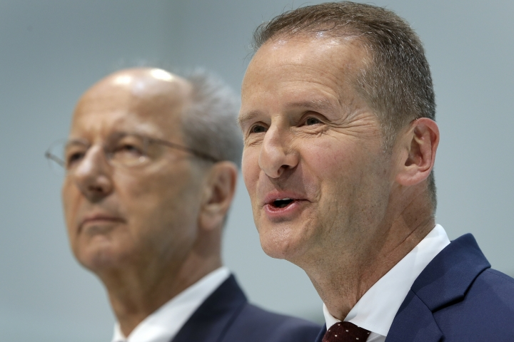 Herbert Diess, right, new CEO of Volkswagen , and Hans Dieter Poetsch, left, chairman of the board of directors of the Volkswagen stock company, address the media during a press conference in Wolfsburg, Germany, Friday, April 13, 2018. (AP Photo/Michael Sohn)