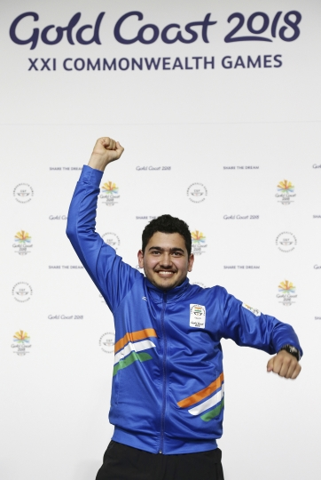 Anish of India celebrates winning gold medal at the men's 25m Rapid Fire Pistol final at the Belmont Shooting Centre during the 2018 Commonwealth Games in Brisbane, Australia, Friday, April 13, 2018. (AP Photo/Tertius Pickard)