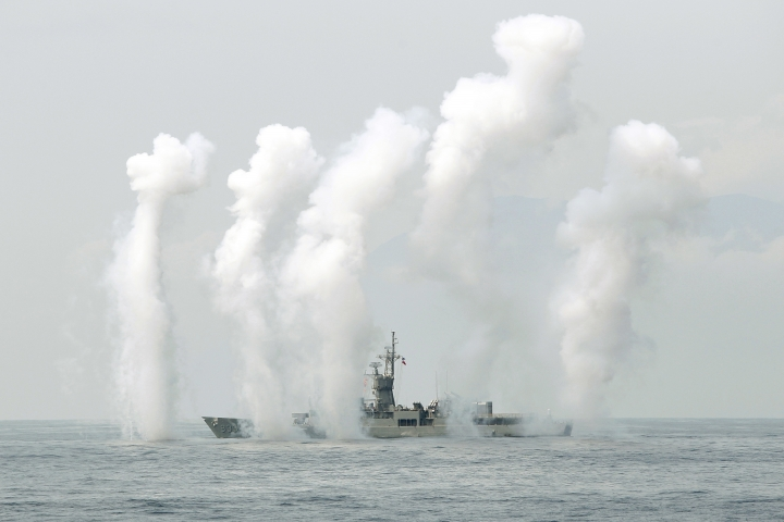 A Taiwan Navy's Knox-class frigate fires chaff during a navy exercise in the bound of Suao naval station in Yilan County, northeast of Taiwan, Friday, April 13, 2018. Taiwan's Armed Forces showed their capabilities of defending the Taiwan Strait with warfare involving submarine, surface ships with helicopter and Air Force strikes ahead of another drill conducted by China next week. (AP Photo/Chiang Ying-ying)