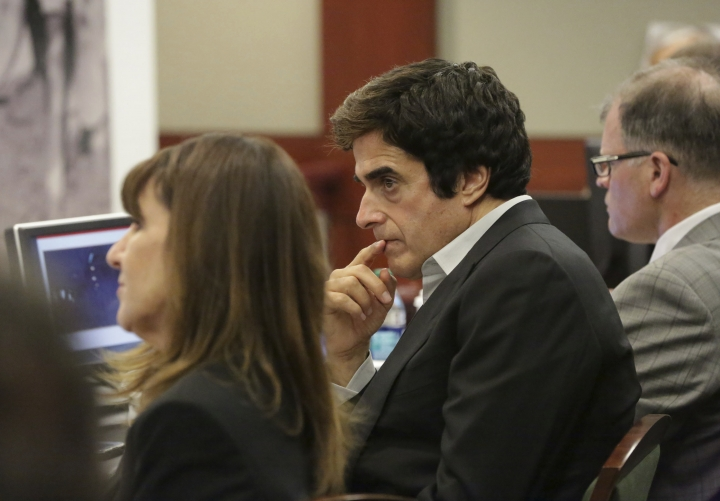 Illusionist David Copperfield, center, looks on during opening statements in a civil trial at the Regional Justice Center in Las Vegas on Friday, April 13, 2018. (Michael Quine/Las Vegas Review-Journal via AP)