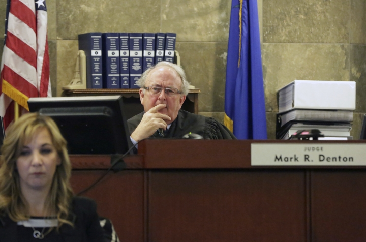 Judge Mark R. Denton listens to opening statements during a civil trial against magician David Copperfield and the MGM Grand at the Regional Justice Center in Las Vegas on Friday, April 13, 2018. (Michael Quine/Las Vegas Review-Journal via AP)