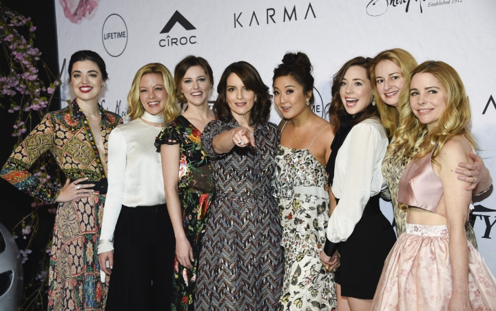 """Honoree Tina Fey, center, is surrounded by the cast of Broadway's """"Mean Girls"""", from left, Barrett Wilbert Weed, Kate Rockwell, Taylor Louderman, Ashley Park, Erika Henningsen, screenwriter Nell Benjamin and actress Kerry Butler at Variety's Power of Women: New York event at Cipriani Wall Street on Friday, April 13, 2018, in New York. (Photo by Evan Agostini/Invision/AP)"""