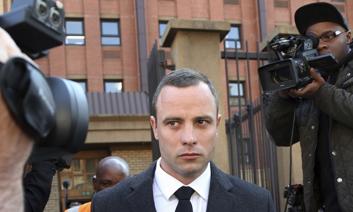 FILE - In this Tuesday, May 20, 2014 file photo, Oscar Pistorius leaves the high court in Pretoria, South Africa during his trial for the 2013 Valentine's Day murder of his girlfriend, Reeva Steenkamp. On Friday, April 13, 2018, The Associated Press has found that stories circulating on the internet that Pistorius has been pardoned, are untrue. (AP Photo/Themba Hadebe)