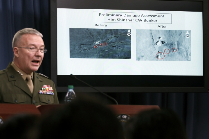 Marine Lt. Gen. Kenneth F. McKenzie Jr., director, Joint Staff, speaks as he shows photographs from before and after the U.S.-led airstrikes against Syria during a media availability at the Pentagon, Saturday, April 14, 2018, in Washington. (AP Photo/Alex Brandon)