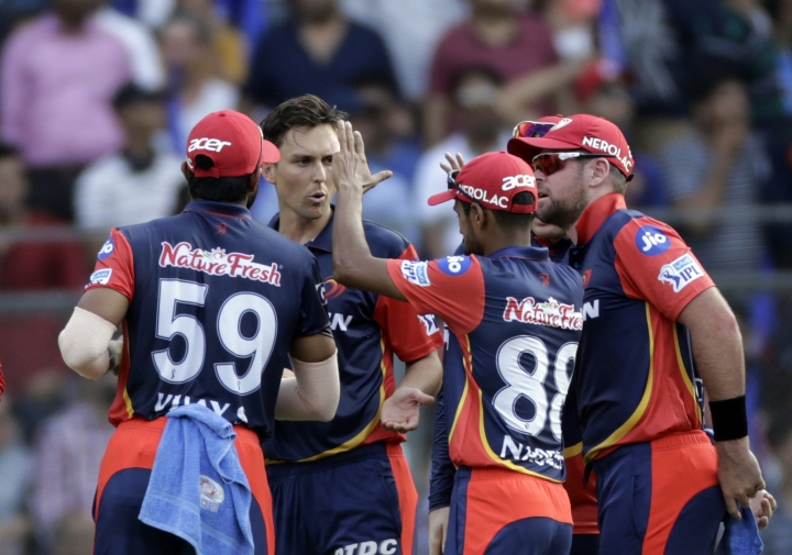 Delhi Daredevils player Trent Boult celebrates after Rohit Sharma's wicket against Mumbai Indians during VIVO IPL cricket T20 match in Mumbai, India, Saturday, April 14, 2018. (AP Photo/Rajanish Kakade)