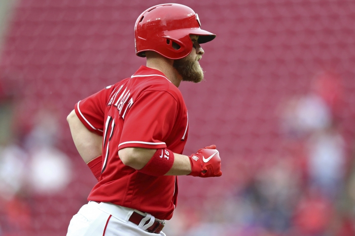 Cincinnati Reds' Tucker Barnhart runs the bases after hitting a home run in the fifth inning of a baseball game against the St. Louis Cardinals, Saturday, April 14, 2018, in Cincinnati. (AP Photo/Aaron Doster)