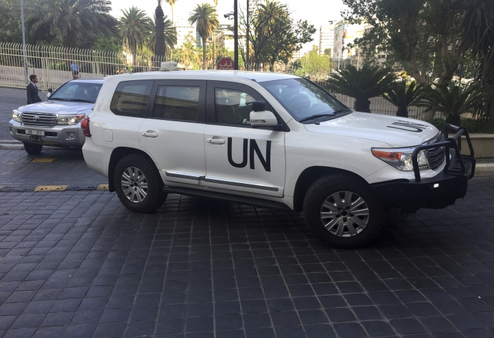 United Nations vehicles carry the team of the Organization for the Prohibition of Chemical Weapons (OPCW), arrive at hotel hours after the U.S., France and Britian launched an attack on Syrian facilities to punish President Bashar Assad for suspected chemical attack against civilians, in Damascus, Syria, Saturday, April 14, 2018. A team of the international chemical weapons watchdog arrived in the Syrian capital Damascus to carry out an investigation into the alleged chemical weapons attack on the town of Douma where opposition activist said more than forty people were killed. (AP Photo/Bassem Mroue)