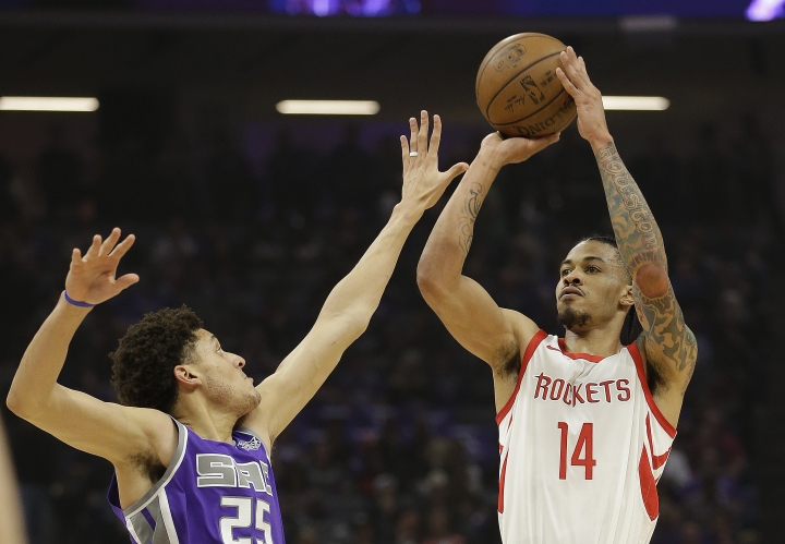 Houston Rockets guard Gerald Green, right, shoots over Sacramento Kings forward Justin Jackson during the first quarter of an NBA basketball game, Wednesday, April 11, 2018, in Sacramento, Calif. (AP Photo/Rich Pedroncelli)