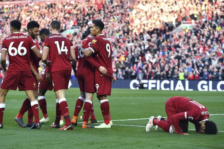Liverpool's Mohamed Salah celebrates scoring his side's second goal of the game during the English Premier League soccer match between Liverpool and Bournemouth at Anfield, Liverpool, England. Saturday April 14, 2018. (Anthony Devlin/PA via AP)