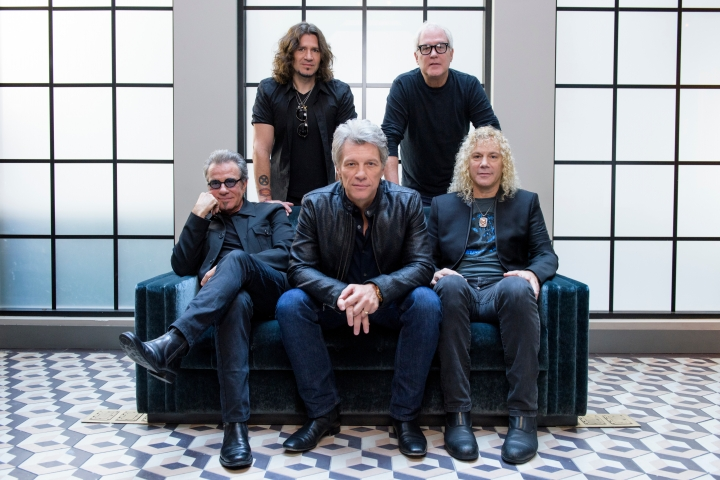 "FILE - In this Oct. 19, 2016 file photo, members of Bon Jovi front row from left, Tico Torres, Jon Bon Jovi, David Bryan, back row from left, Phil X, and Hugh McDonald pose for a portrait in promotion of their new album ""This House is Not for Sale"" in New York. The band will be inducted to the Rock and Roll Hall of Fame on April 14, 2018 in Cleveland, Ohio. (Photo by Drew Gurian/Invision/AP, File)"