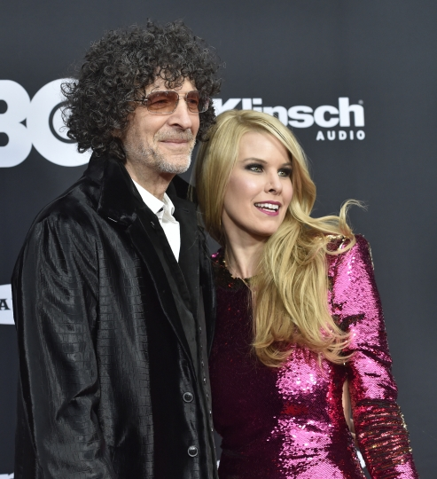 Howard Stern and his wife, Beth, arrive at the red carpet before the Rock and Roll Hall of Fame induction ceremony, Saturday, April 14, 2018, in Cleveland. (AP Photo/David Richard)