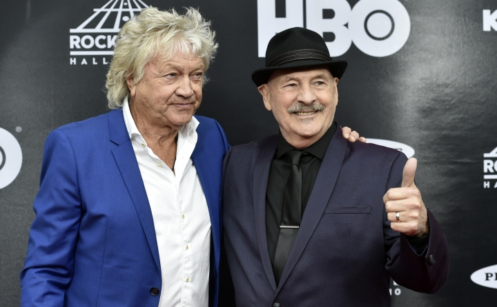 John Lodge, left, and Mike Binder, both members of the Moody Blues, arrive on the red carpet before the Rock and Roll Hall of Fame induction ceremony, Saturday, April 14, 2018, in Cleveland. (AP Photo/David Richard)