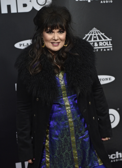 Ann Wilson, from the band Heart, arrives on the red carpet before the Rock and Roll Hall of Fame Induction ceremony, Saturday, April 14, 2018, in Cleveland. (AP Photo/David Richard)