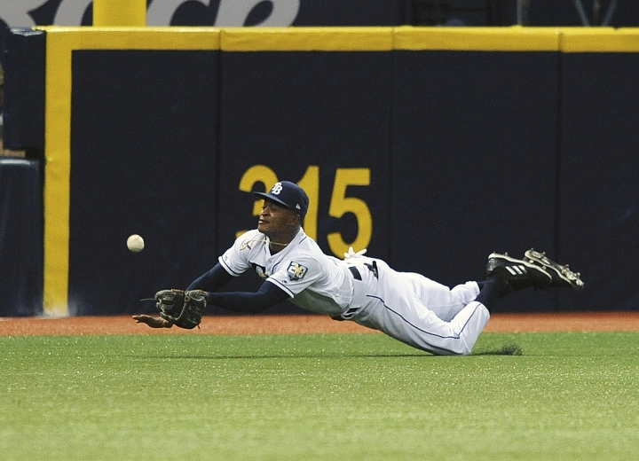 Tampa Bay Rays left fielder Mallex Smith robs Philadelphia Phillies' J.P. Crawford of a base hit during the fifth inning of a baseball game Saturday, April 14, 2018, in St. Petersburg, Fla. (AP Photo/Steve Nesius)
