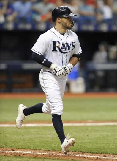 Tampa Bay Rays' Johnny Field, making his major league debut, jogs toward first base after walking against Philadelphia Phillies starter Jake Arrieta during the seventh inning of a baseball game Saturday, April 14, 2018, in St. Petersburg, Fla. (AP Photo/Steve Nesius)