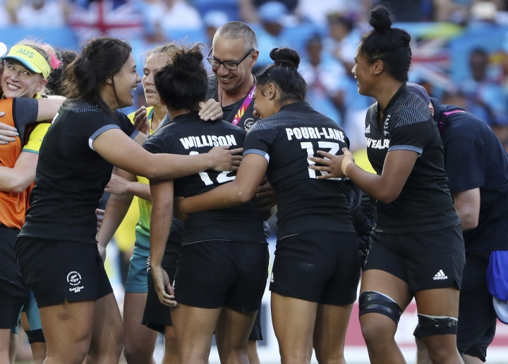 New Zealand players celebrate after defeating Australia in extra time in their women's rugby sevens gold medal match at Robina Stadium during the 2018 Commonwealth Games on the Gold Coast, Australia, Sunday, April 15, 2018. (AP Photo/Rick Rycroft)